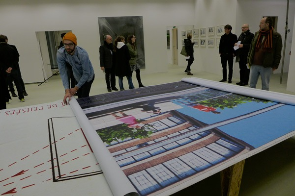 Installation view, rolled billboards on table, Koln, BCC 2014